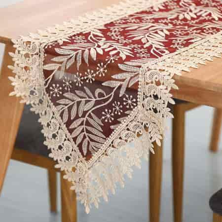 camino de mesa transparente bordado con hojas de ornamenta