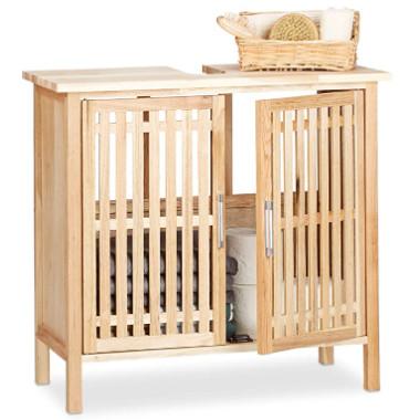 Mueble bajo baño de madera con hueco para el lavabo.