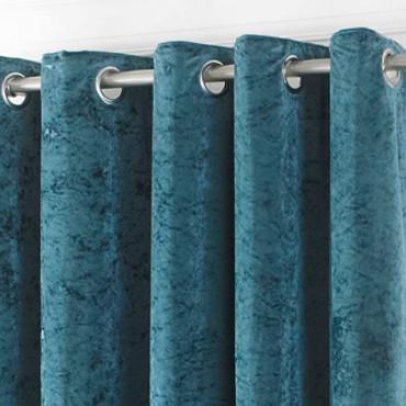 cortinas de color verde azulado hechas con terciopelo de buena calidad.