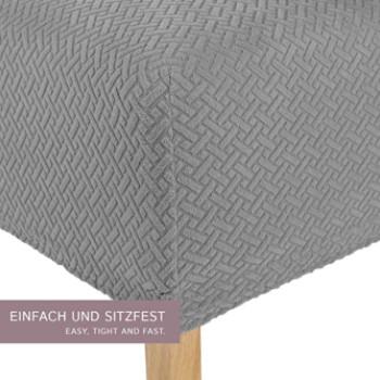 Una imagen que muestra la funda para sillas del comedor aumentada con zoom para ver los detalles del diseño.