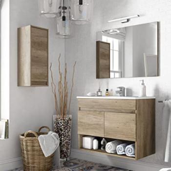 Conjunto de muebles a juego para el cuarto de baño instalado en un cuarto de baño pequeño.